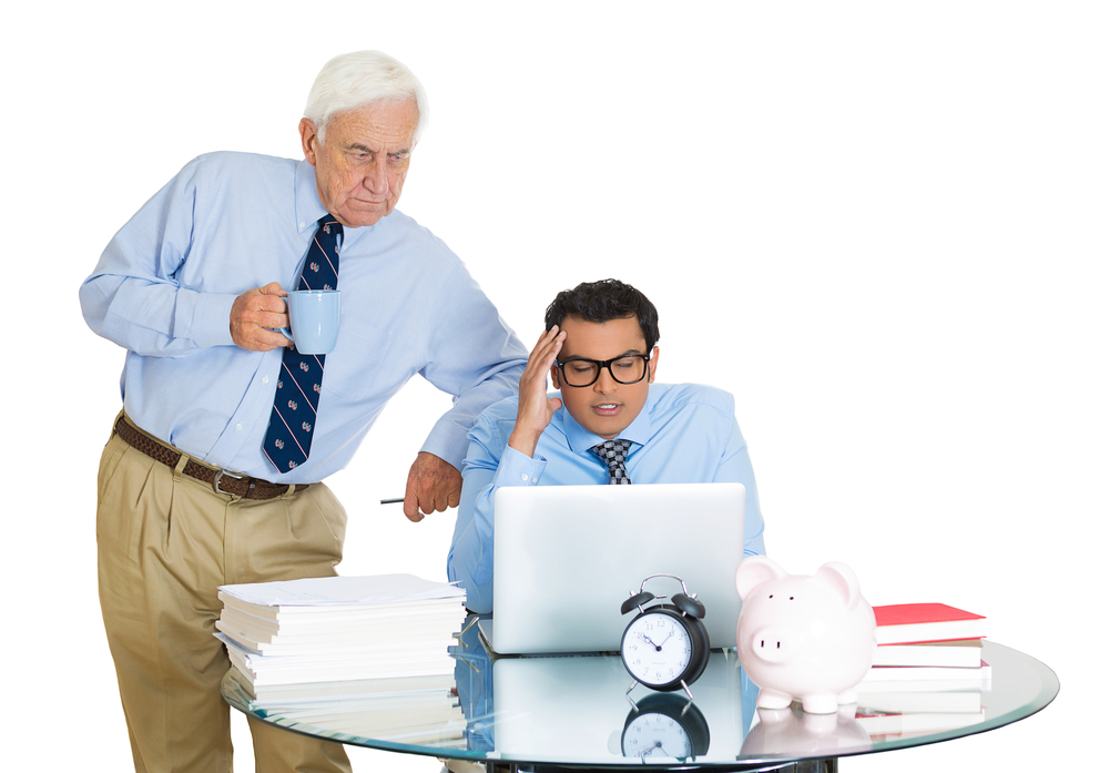 Closeup portrait of old elderly business man boss, checking on his young employee, pushing to work hard on project, who is in disagreement unhappy, isolated on white background. Conflict at work place