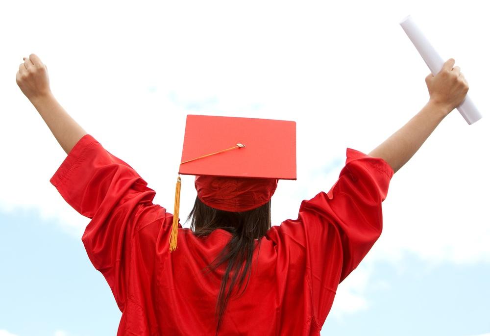 Graduate student celebrating her academic success.jpeg