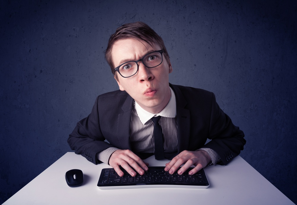 Hacker working with keyboard and mouse on blue background.jpeg