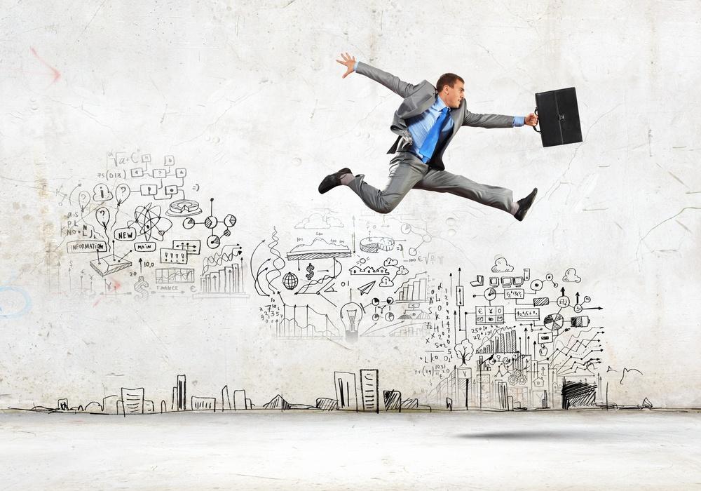 Image of businessman in jump against sketch background.jpeg